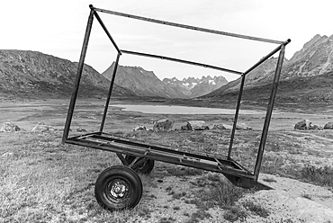 View of abandoned trailer in the middle of nowhere in South Greenland against mountains