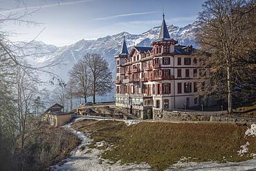 Exterior of hotel against mountains, Interlaken, Bern Canton, Switzerland