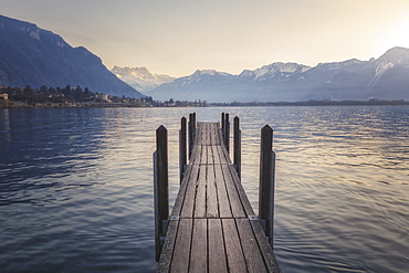 View of jetty on shore of Lake Geneva at sunset, Switzerland
