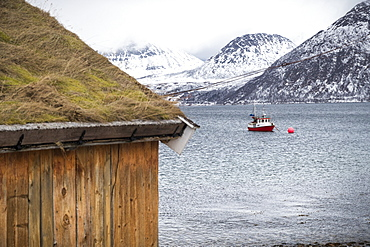 Fishing boat in water off the coast of Tromso, Norway
