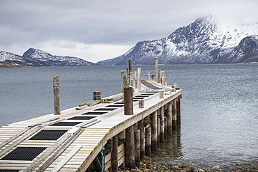View of pier without boats on coast of Tromso, Norway