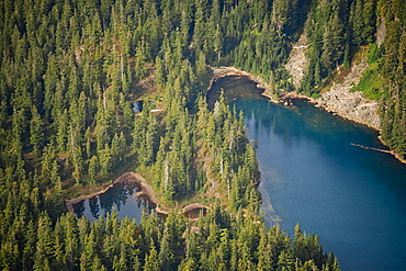 Beautiful natural scenery of an alpine lake surrounded by forest, Coast Mountains, Vancouver, British Columbia, Canada