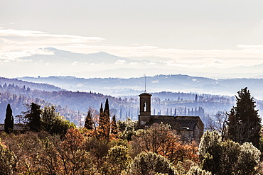 Typical Tuscan landsape with a church spire.
