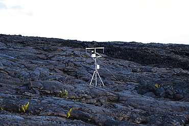 Weather station collecting data for the national park and weather service planted on old lava flows in Hawaii Volcanoes National Park