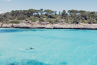 Man swims along shore, Mallorca, Balearic Islands, Spain