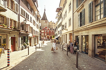 Scarce pedestrian traffic in picturesque of town street, Zurich, Switzerland