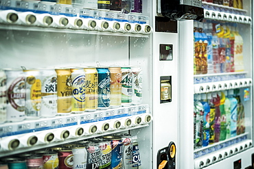 Rows of various canned drinks inside vending machine, Arashiyama, Kyoto, Japan