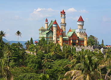 Palm trees in front of Fantasy World castle in Lemery, Tagaytay, Batangas, Philippines