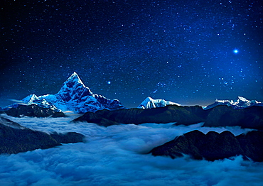 Landscape with starry sky over sea of clouds and snowcapped mountains, Pokhara, Kaski, Nepal