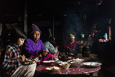 Three generation family eating together in small rural house, Myanmar, Shan, Myanmar