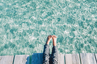 Close up of the kids feet over turquoise waters, Mallorca, Balearic Islands, Spain