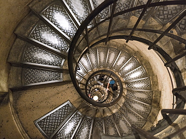 View down spiral staircase in Triumphal Arch, Paris, France