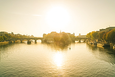 Sunrise on Seine River with Pont neuf or new bridge and isle de la cite where Notre Dame Cathedral is located, Paris, Ile-de-France, France