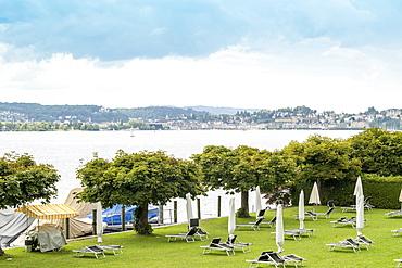 Landscape with LakeZug, trees and beach chairs,Zug, Switzerland
