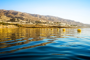 View from water of Dead Sea shoreline in Madaba Governorate, Jordan