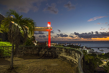 View from terrace on town with harbor at sunset, Salvador, Bahia, Brazil