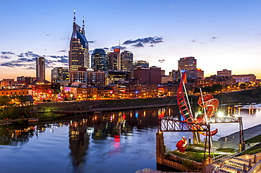 Modern cityscape with Cumberland River and ATT Building at sunset, Nashville, Tennessee, USA