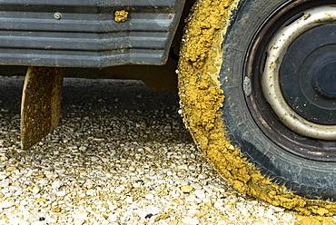 Close up on muddy van tire on stony ground, Algarve, Algarve, Portugal