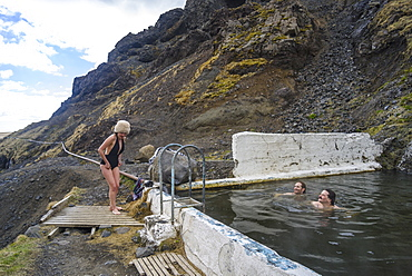 Group of young friends in Icelandic hot springs, Iceland