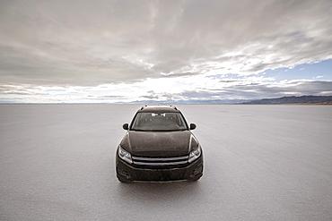 Front view of SUV parked on Bonneville Salt Flats, Wendover, Utah, USA