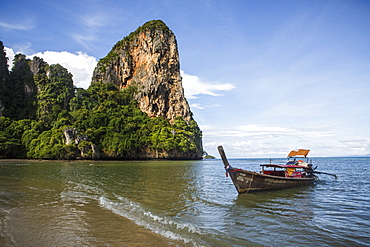 Railay Beach near Krabi, Thailand offers pristine ocean views on the Andaman Sea. The beach is a popular tourist destination located east of Phuket.