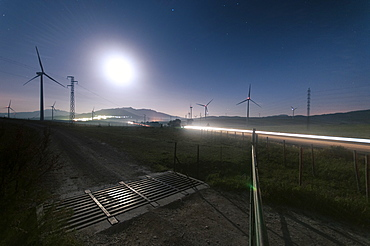 View of silhouettes of wind turbines at night, Tarifa, Andalucia, Spain
