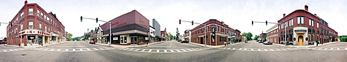A 360 degree view from the middle of a four corner intersection in Farmington, Maine. This picture was taken with a panoramic camera that rotates as it exposes the film.