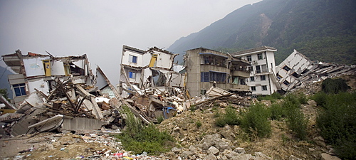 A view of collapsed buildings in Beichuan Town, which was severely damaged by a powerful 7.9 earthquake. The Chinese government raised the death toll to 21,500 but has said fatalities could rise above 50,000. Tens of thousands could still be buried in collapsed buildings in Sichuan province, where the quake was centered.