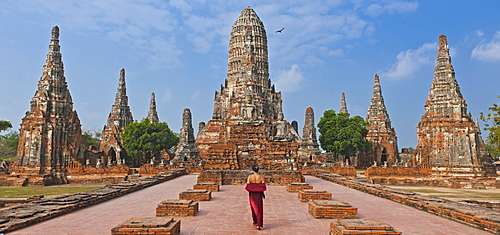 woman in red dress at the ancient temple of Wat Chaiwatthanaram in Ayutthaya