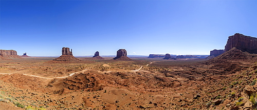 Navajo Nation's Monument Valley Park. This great valley boasts sandstone masterpieces that tower at heights of 400 to 1,000 feet. framed by scenic clouds casting shadows that graciously roam the desert floor. The angle of the sun accents these graceful formations, providing scenery that is simply spellbinding, Arizona, United States of America.
