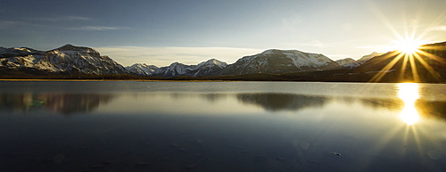 Sunrise over mountains and lake, winter
