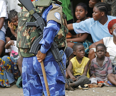 Football game in West point, Monrovia, Liberia.  All female Peacekeeping police force from India are part of the UN's Form Police Unit which provides backup on patrol for local unarmed Liberian National Police  .
