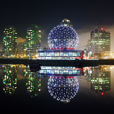 The Telus World of Science (Science World) is reflected in False Creek, Vancouver, BC.