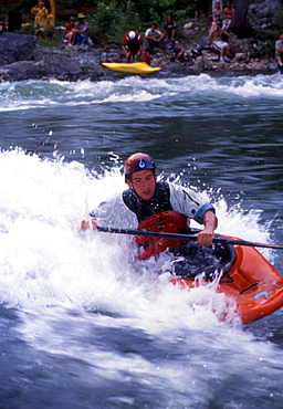 James Mole, professional kayaker... Every year, hardcore whitewater fanatics migrate to the riverside community of Kingfisher, British Columbia to play in the Shuswap River on one of the finest natural standing waves the province has to offer. This collection of images were taken over a hot July weekend during the 2003 Annual Kayak Rodeo competition.