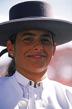 In Sevilla, locals show their equine history and flamenco spirits by parading their horses and wagons while dawning traditional flamenco dresses and flat brimmed hats.