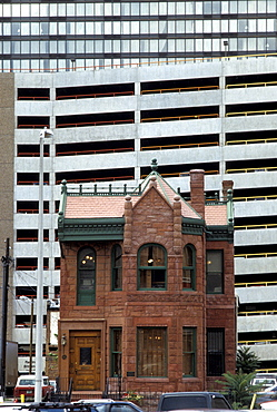 Victorian-era building and modern architecture in Denver, Colorado