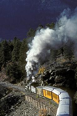Coal-fired, steam-powered locomotive of the Durango & Silverton Narrow Gauge Railroad on the tracks between Silverton and Durango, Colorado.