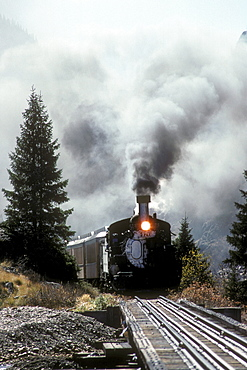 Coal-fired, steam-powered locomotive of the Durango & Silverton Narrow Gauge Railroad on the tracks near Silverton, Colorado.