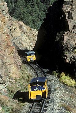 Pop cars, or maintenence cars, of the Durango & Silverton Narrow Gauge Railroad on the tracks between Durango and Silverton, Colorado