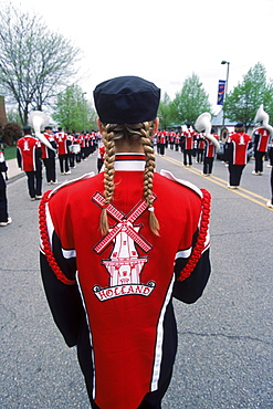 A windmill on the back of a marching band member in a parade during Tulip Festival in Holland, Michigan participating in the Meijer Muziekparade.