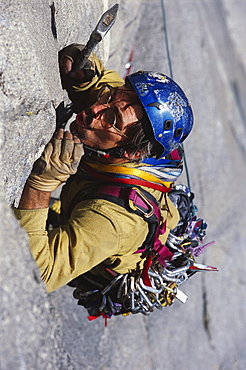 Tom McMillan blowing out a seam to place protection while making an ascent.