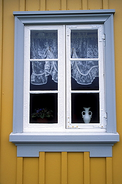 Window on an historic building at Glaumbaer, northcentral Iceland. An important discovery was made in Glaumbaer in 2001: the homestead of Thorfinn Karlsefni, the father of the first European born in the New World. This find has important implications for Viking history.