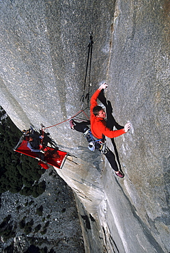 Tommy Caldwell doing the second free ascent of The Zodiac on El Capitan, Yosemite National Park, California. Caldwell is one of the worlds leading rock climbers. In the lower third Caldwell's climbing partner, Kevin Swift, is visible belaying while laying on his portaledge.