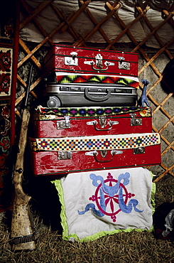 Interior of a ger. The internal layout of a ger is universal throughout Mongolia. Treasured possesions are kept in suitcases and boxes in the back of the ger. Tavanbogd National Park, Mongolia.