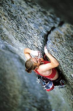 Beth Rodden rock climbing, crack climbing on the famous Phoenix 5.13a finger crack in Yosemite National Park, California.