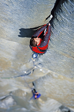 Tommy Caldwell rock climbs a crack on the headwall of The Salathe Wall 5.13 on El Capitan in Yosemite National Park, California. Caldwell is a professional rock climber and has free climbed more on El Capitan than any other climber.