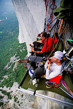 Bob Porter and Martin Avidan rest and eat dinner on a portaledge while rock climbing, aid climbing, big wall climbing up the Zodiac 5.13+ on El Capitan in Yosemite National Park, California. The team spent three days and two nights on the big wall.