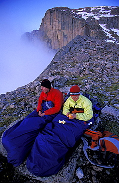 Tommy Caldwell and Beth Rodden keep warm in their sleeping bags at their bivy site while camping high on a ridge off of Longs Peak in Rocky Mountain National Park, Colorado. The Diamond is a 2000 thousand foot rock face popular for rock climbing (see background).
