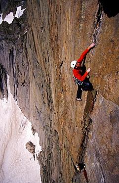 Tommy Caldwell rock climbing a crack on Directisma 5.10a Rocky Mountain National Park, Colorado.