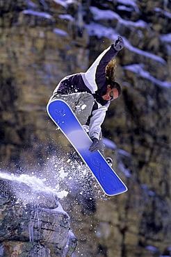 Steve Fry jumping with a snowboard at Snowbird, Utah.